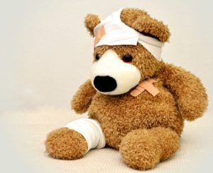 teddy bear with bandages wounds
