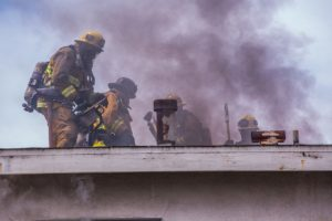 firefighters on house on fire